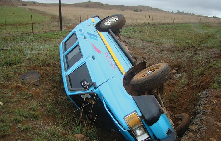The overturned vehicle in the ditch