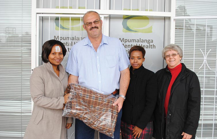 Nelly Ntshangase, Bartie Coetzee, Khetiwe Ntshangase and Annatjie Nel while handing over the blanket
