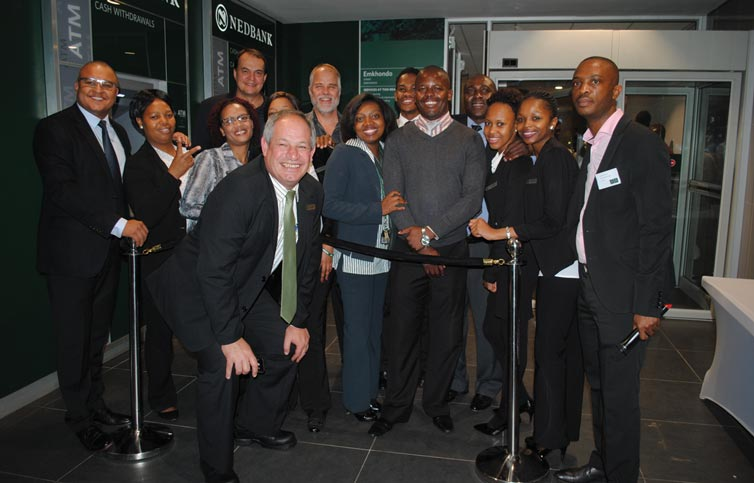 The Nedbank team in front of the main entrance to the bank