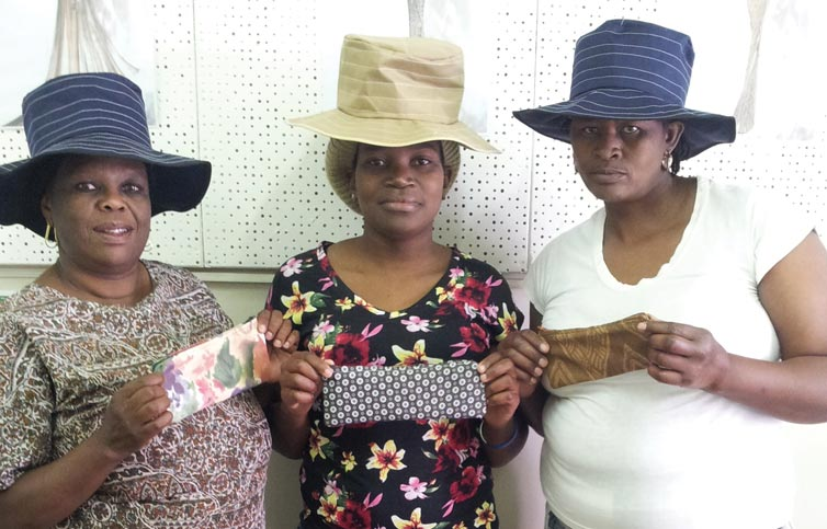 Delisile Vilakazi, Thandeka Madonsela and Fikelephi Makhoba with their hats and pencil bags that they have sewn