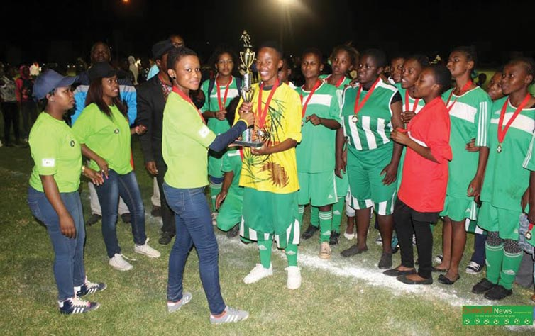 Amadlelo Secondary girls receive their trophy