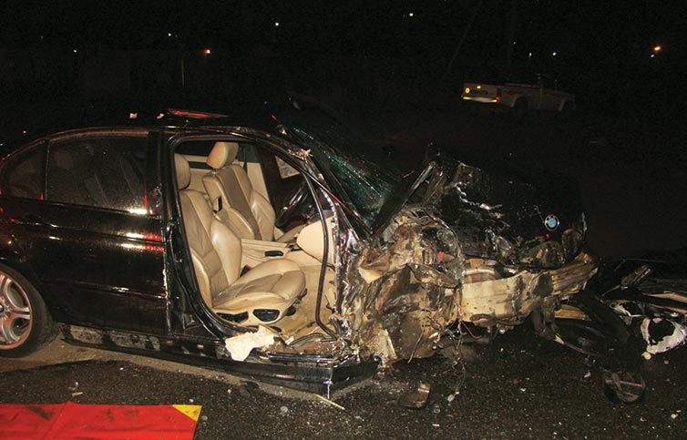 The BMW after the driver had been cut out of the wreck