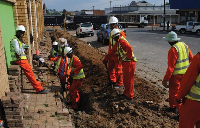 Workers hard at work to complete the trench for the new cable