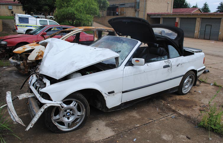 The white BMW that had crashed through the wall and fence