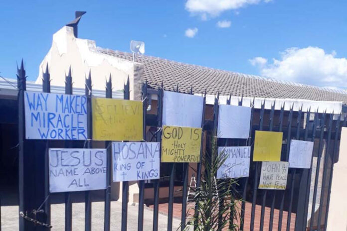 Bible verses on front gate