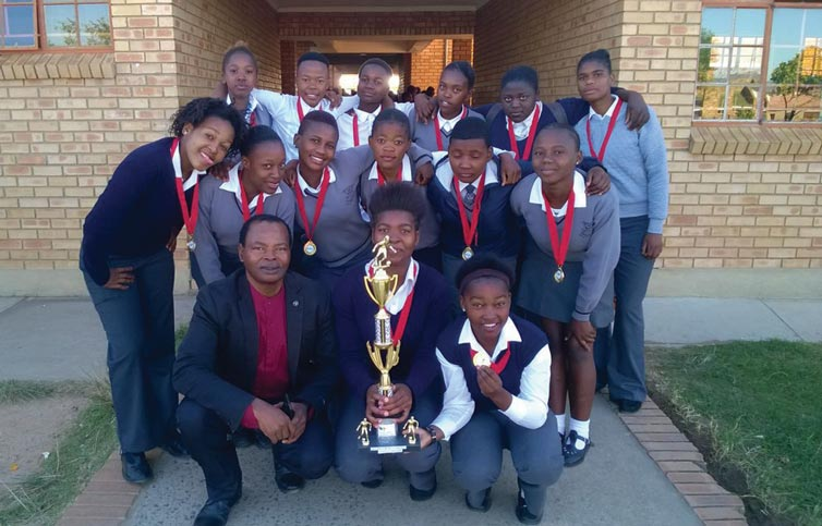 The U/17 girls soccer team with their coach, Mr D.K. Shongwe