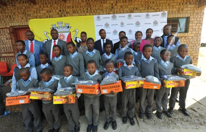 Executive Mayor, Cllr Muzi Chirwa, hands over School Uniforms to Schools