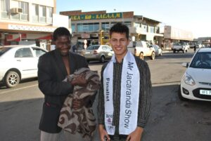 Dylan handing out blankets to the homeless in Piet Retief